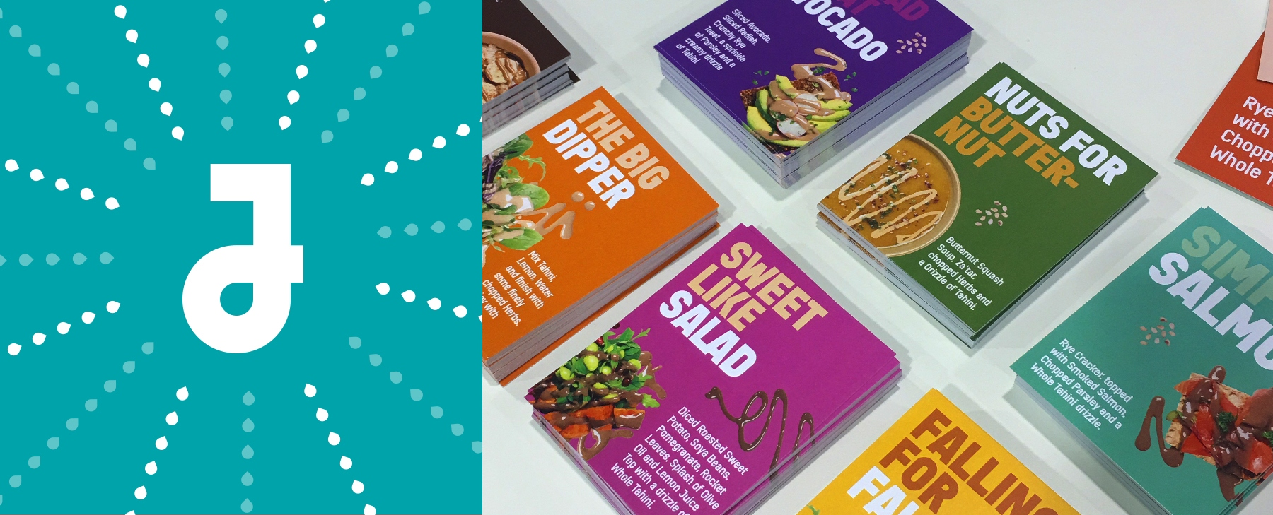 Julia's J logo with sesame seed feature and photograph of A5 branded leaflets on a table