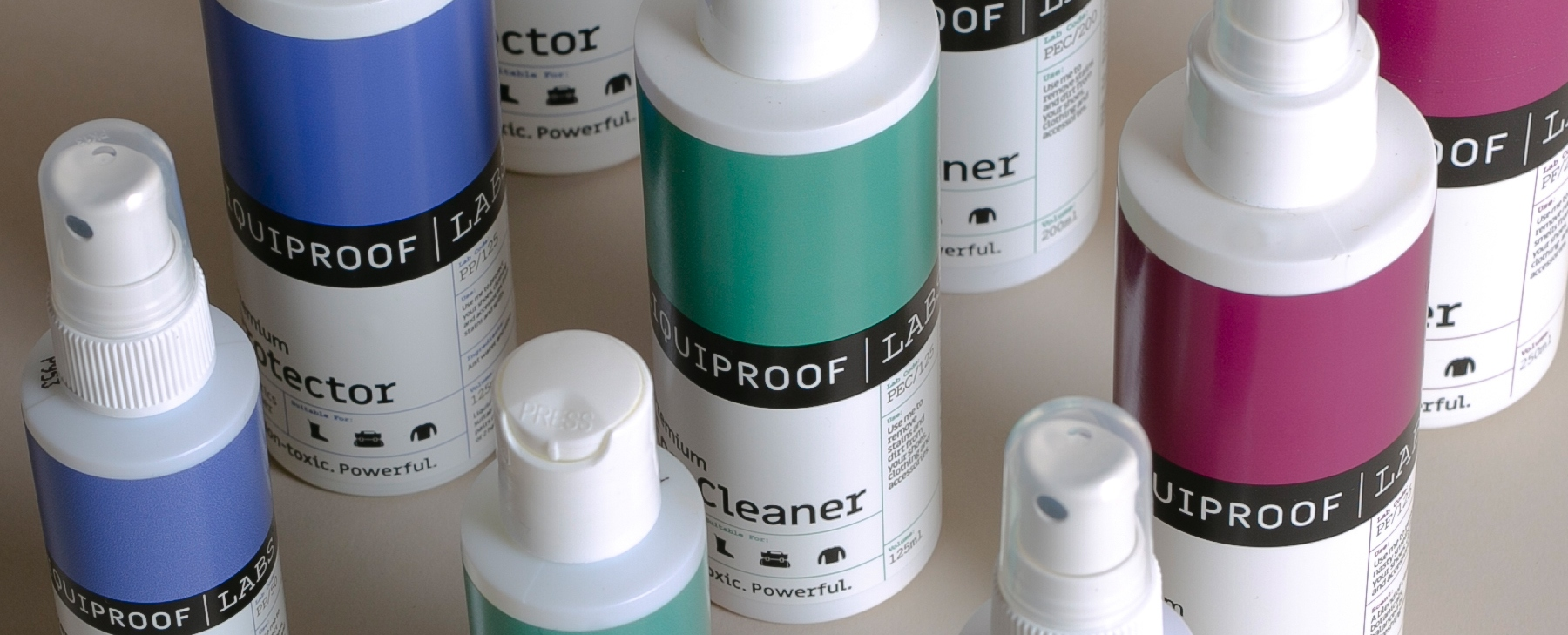 bottles of Liqiproof protector and cleaner showing new brand design with blocks of colour